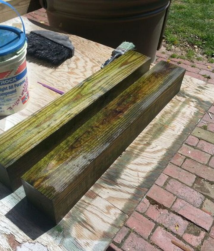 pressure treated 4x4s treated further with copper-based wood preservative.