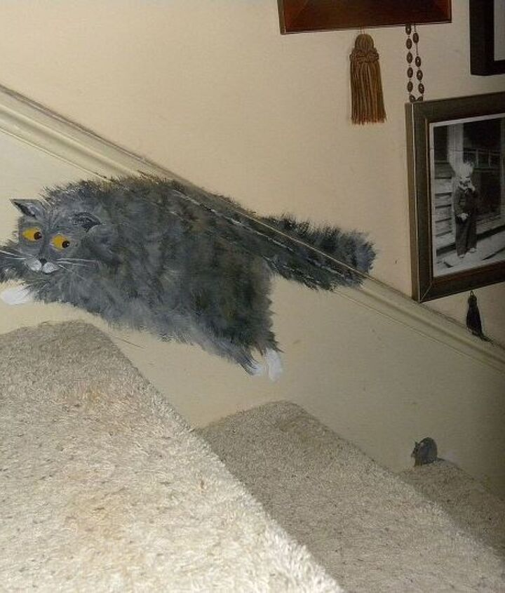 cat and mouse on front stairway