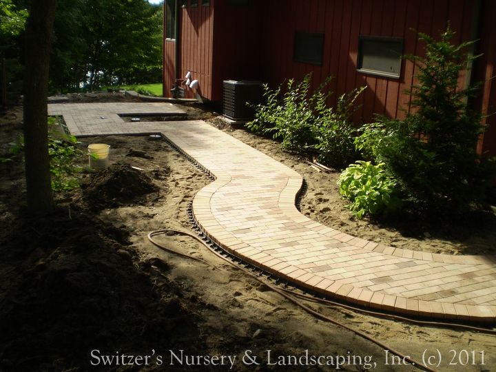 """Before the installation of the """"Classic Cedar Pergola"""" it is easy to see the traffic pattern established by the paver walk."""
