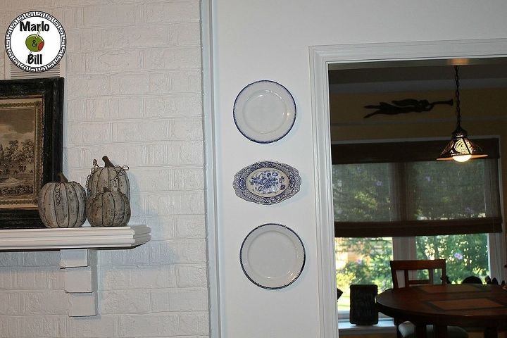 """Found"" featheredge and flow blue plates that gave a small wall a new look."