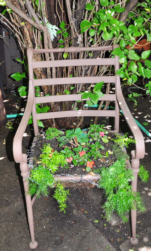 Turn old furniture into a planter with a little wire, moss, dirt and flowers.