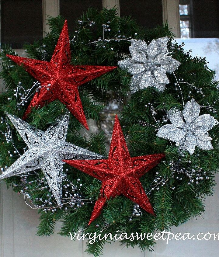 Faux evergreen wreath decorated with dollar store gittered ornaments