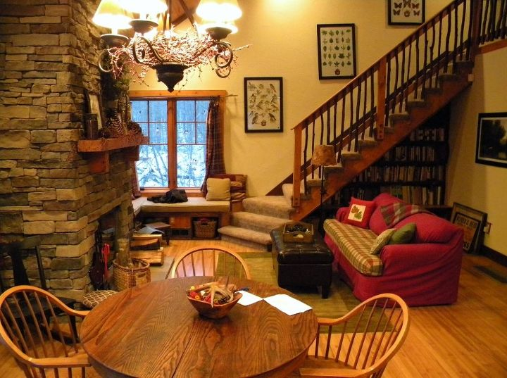 The open dining and living room with stairs up to the loft.
