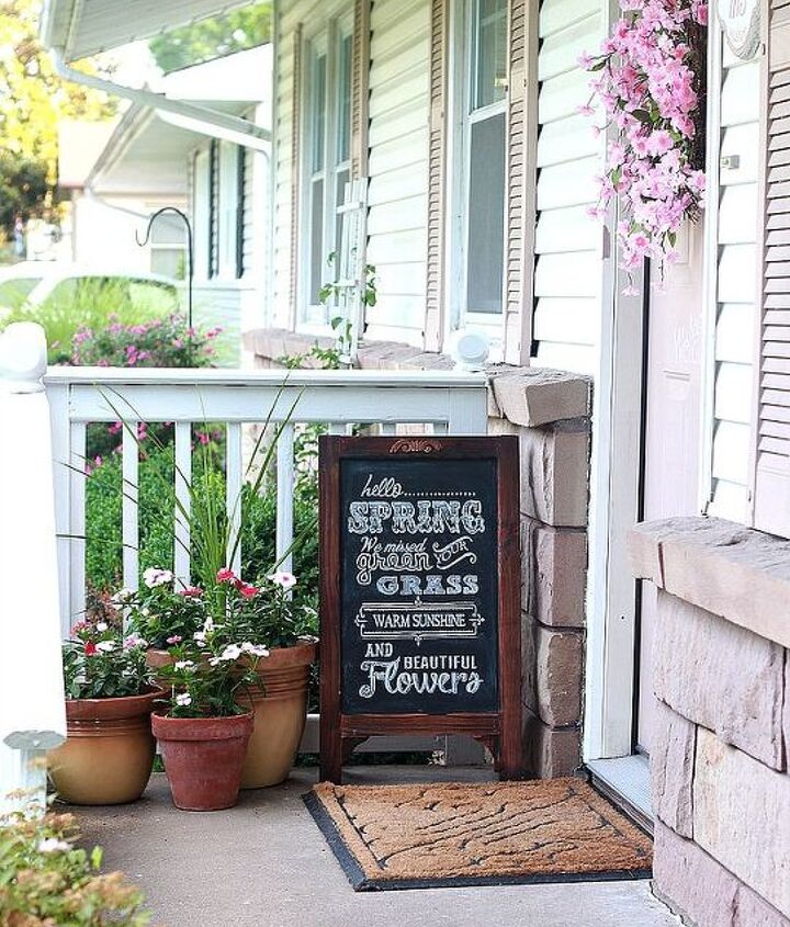 Instant character added with a new wreath, potted flowers, & an easel chalkboard.