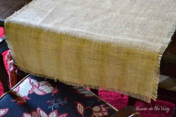 Leave about 6 inches on each end, allowing the table runner to fall over the edge of the table.