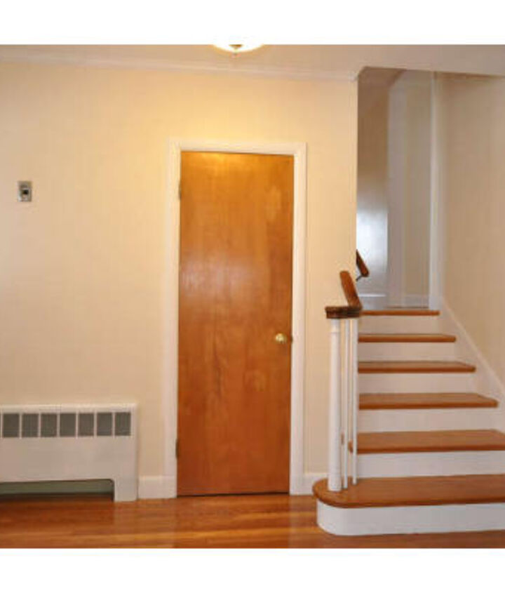 The entryway started off with dark doors and neutral walls.