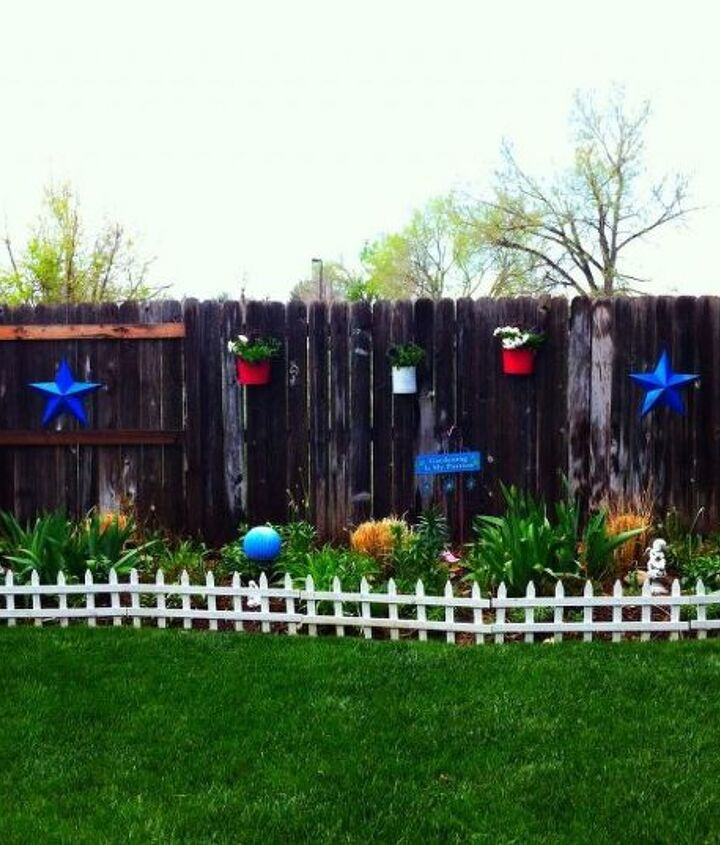 Our wooden fence is now darn close to being as pretty as the rest of the garden and all I had to buy were a couple of cans of spray paint!