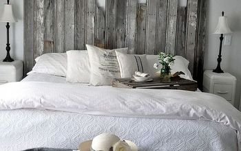 reclaimed wooden headboard, home decor, woodworking projects, A vintage cowboy tub at the end of the bed provides storage for extra pillows and quilts