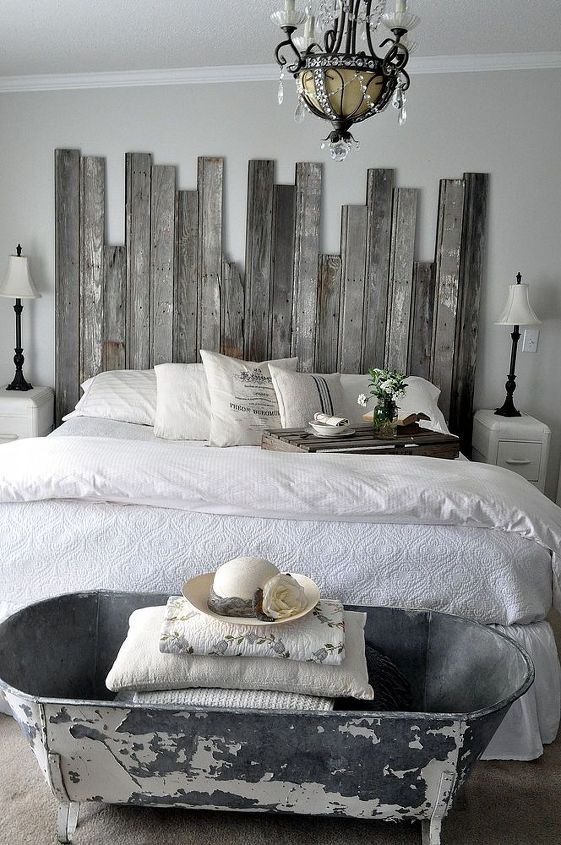 A vintage cowboy tub at the end of the bed provides storage for extra pillows and quilts.