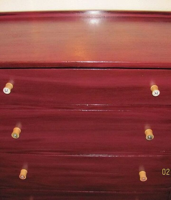 An old, plain dresser dressed up with stain and inexpensive wood spools.