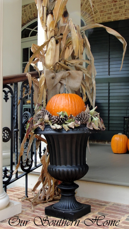 simply place a pumpkin in the center of the urn and fill in with dried leaves and pine cones from your yard or woods