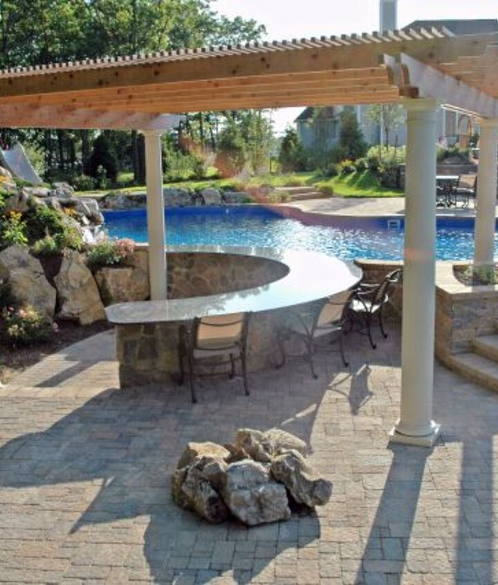 Pool-Side Bar: This 32-foot, U-shaped swim-up granite-topped bar, in cultured stone and rock facing, curves around to be enjoyed from patio as well.