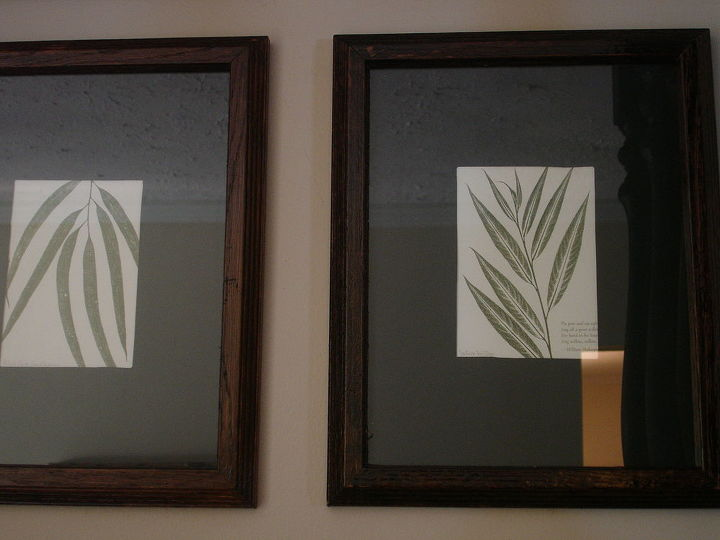 n addition to the spindles, I removed the old sign and created a gallery wall of botanical prints.