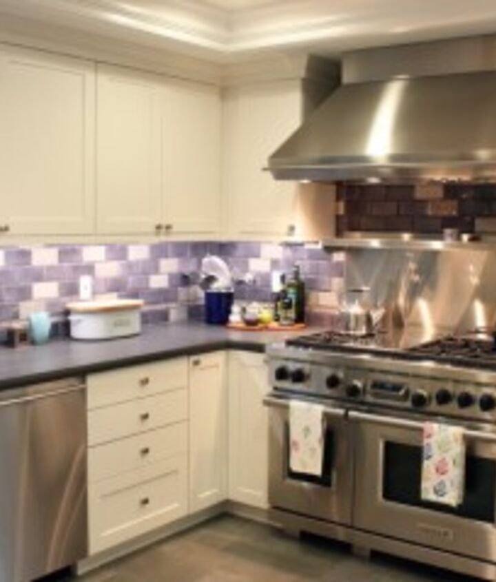 Purple Fixtures: A colorful backsplash is a great way to add interest to neutral walls and cabinets