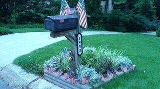 i need a suggestion for a mailbox it s a road side country type on a post, curb appeal, My mailbox decked out for 4th of July Even with a very hot west exposure this small garden area always looks healthy If I could get the rest of my gardening to do as well