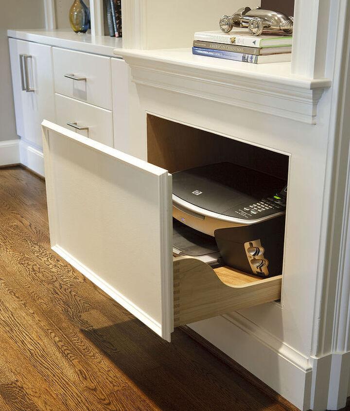 A secret drawer hides a bulky printer.
