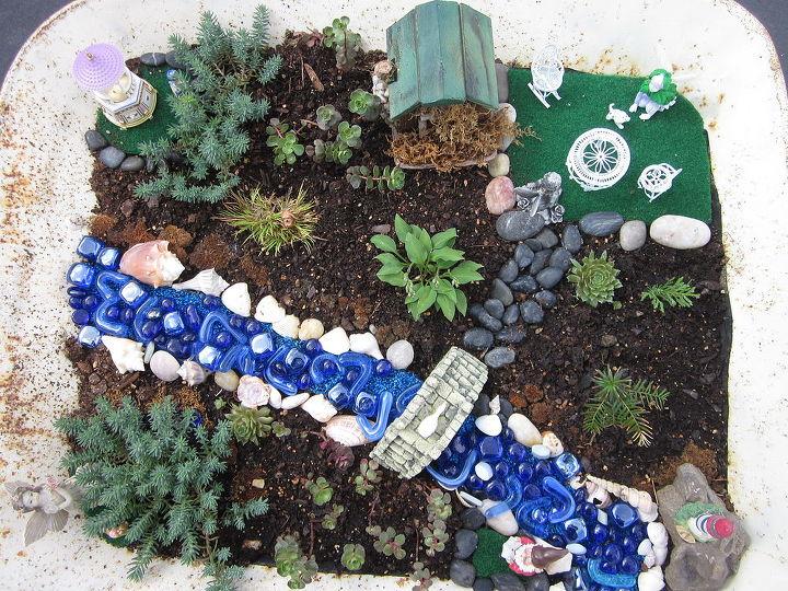 fairy garden i made in a wheel barrow, gardening, Fairy garden I made in a wheelbarrow