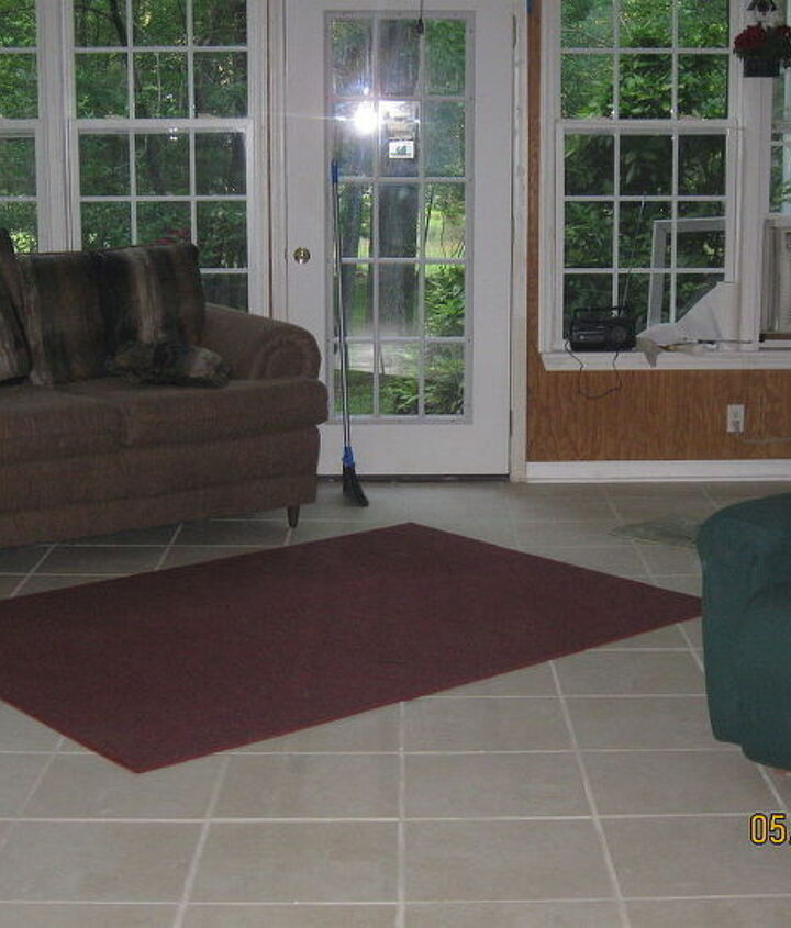 Finally finished sunroom with tile over cement floor. Absolutely love and enjoy this room.