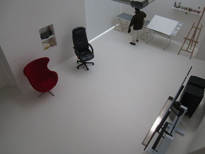 Viola.  The all white surfaces in the studio allow the art to stand out, yes even the floor art (-j