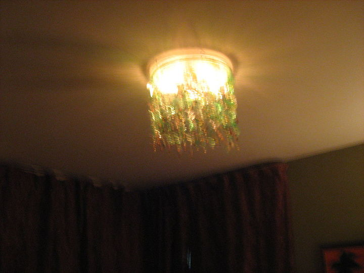 i wanted a chandalier but i wanted what i wanted so i made it i used water, lighting, repurposing upcycling
