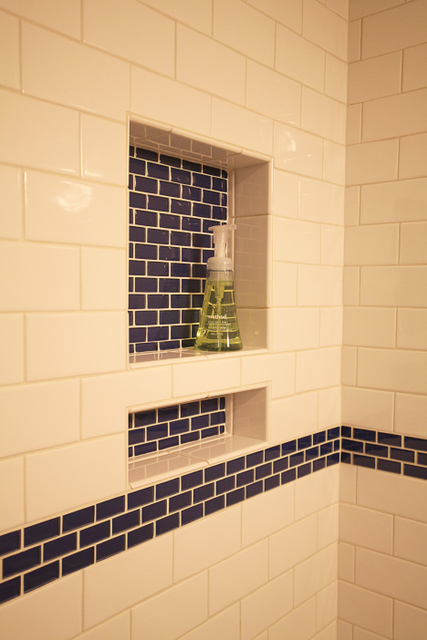 A cubby for soap and one for taller shampoo make for a nice touch and keeps the tub deck clean