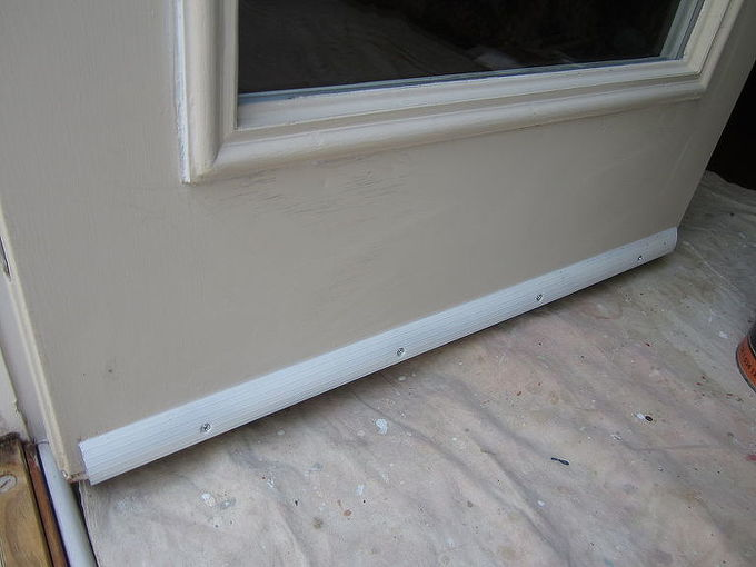 prevent door bottoms from rotting or rusting by installing a drip edge, doors, home maintenance repairs, The new drip edge primed installed and caulked to the door Like most exposed metal doors rust was beginning to form on the face from the bottom