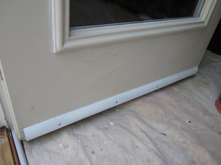 The new drip edge primed, installed and caulked to the door.  Like most exposed metal doors, rust was beginning to form on the face from the bottom.