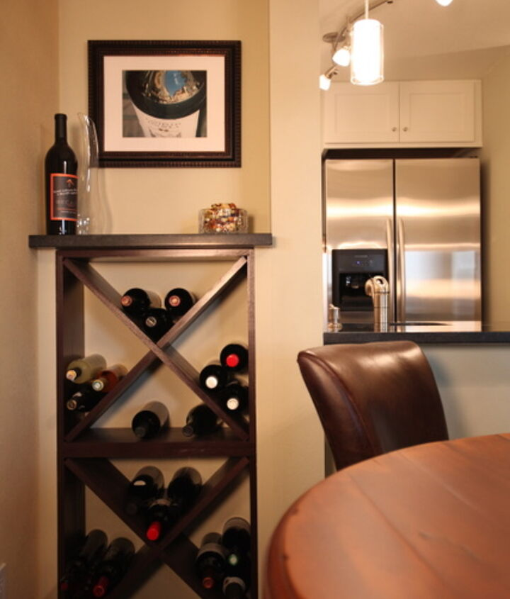 """Condos can be tricky.  We had hoped to install a recessed wine cooler in this area but were thwarted by plumbing vents that could not be moved.  This 9"""" deep alcove fit a pair of wine cubes perfectly.  The area was trimmed out to look built in."""