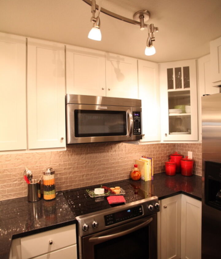 """The kitchen storage was maximized in several ways.  The cabinets were taken to the ceiling and we chose to install 15"""" deep upper cabinets.  Both corners in the kitchen maximized storage with a super susan and a corner cabinet instead of blind corner"""