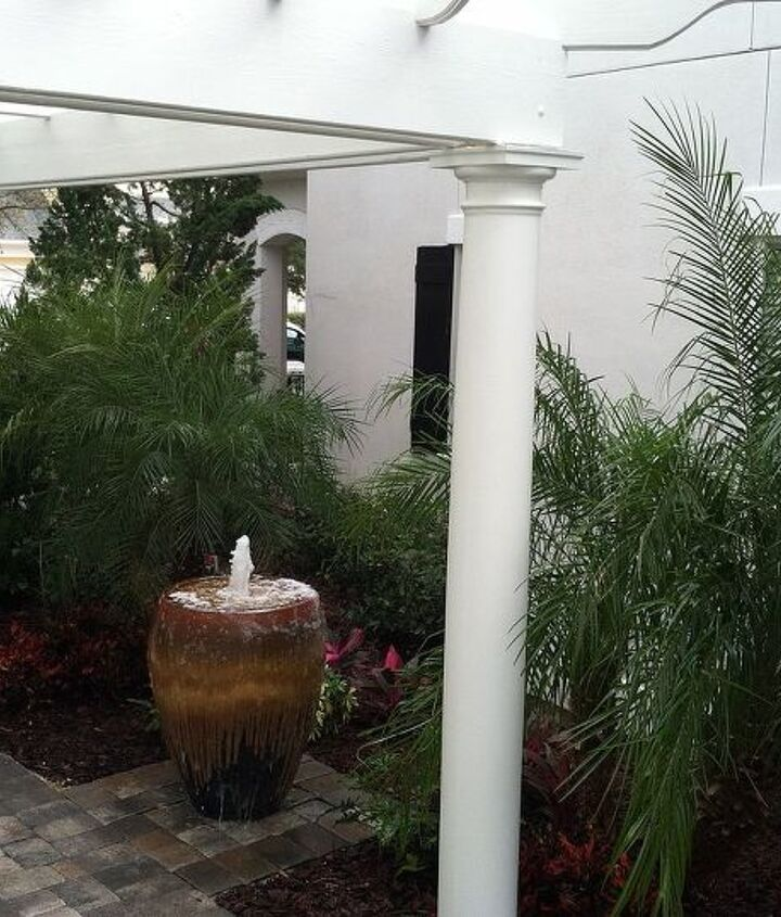 Lower patio, pergola and water feature. Notice the privacy created by the large Podocarpus