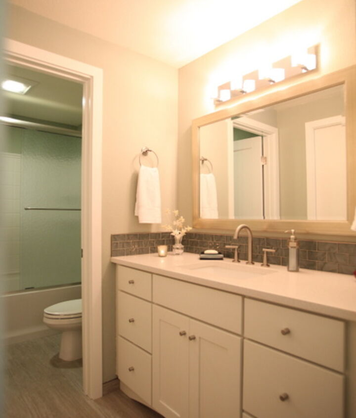The bathroom was completely updated and maximized available storage.  The old vanity had a single sink off to one side and a useless open area for seating.  We moved the sink to center and added drawers to each side for husband and wife.