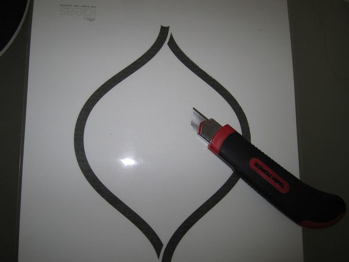 I downloaded this free stencil from Lowes website. Printed it as Fedex and laminated it. Cut it with an exacto.