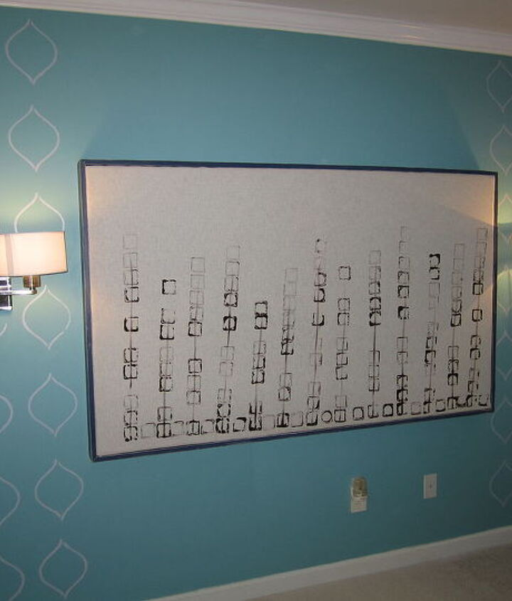 Stencil is done and headboard is hung on the wall. What a pretty sight.