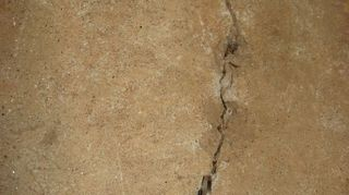 q getting someone to diagnose garage floor cracking, concrete masonry, flooring, garages, home maintenance repairs