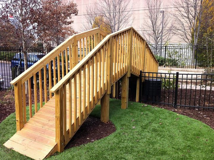We needed to separate the play area from the planting and garden area while still allowing the kids to go from one to the other, so we created a bridge.  It slows and channels the flow of the kids without needing a gate.