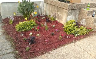 this is my first try at any real gardening the two mulched beds out front of my home, gardening