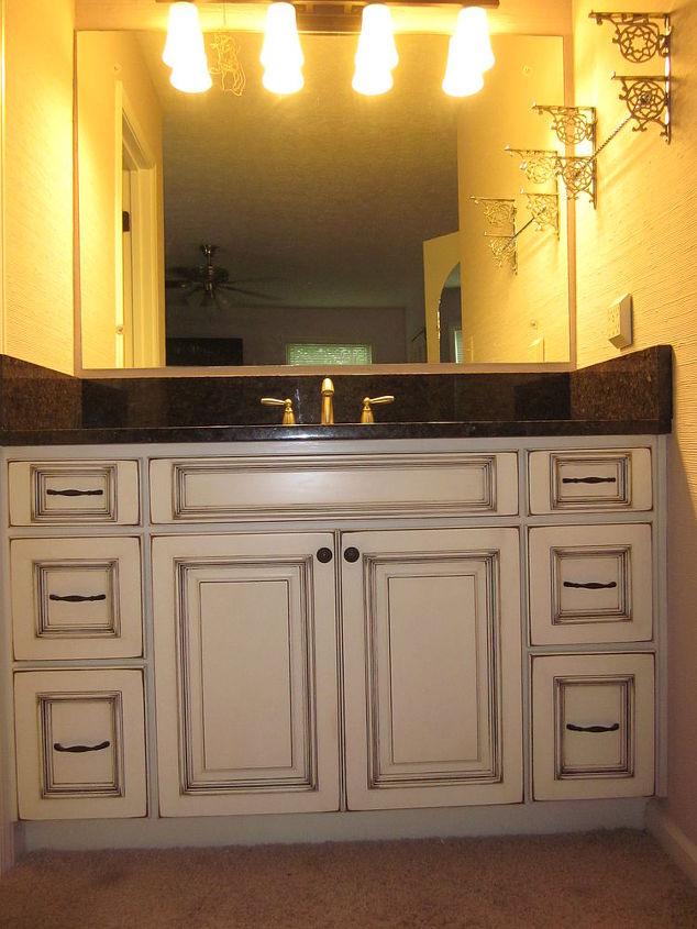 Door Style: Kenton Elite Wood Species: Maple Finish: Paint White with Black Antique Rub Through Labrador Antique Granite