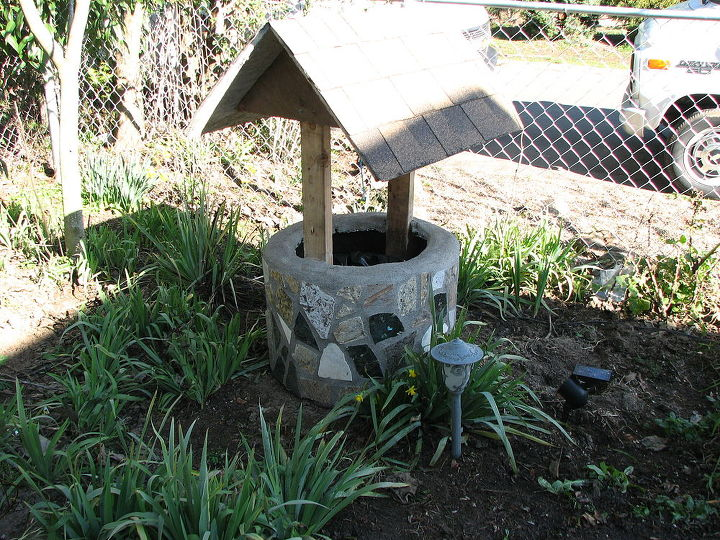 and came up with this.my wells have graduated up to having cedar shake roofs, little bucket and chian hanging inside.then incorperated a liner inside and pumped water up nand in so was cascading back in. or could remove bucket and put hanging basket so plants would hang out and over. well everone now wanted maching planters and wells.Ive even made some fountains that were reaslly cool but cant find photos.in the last 10 years ive probably made and sold 250 of them I figure im in them about 30 bucks a piece and get 250.00 with pump and liner.