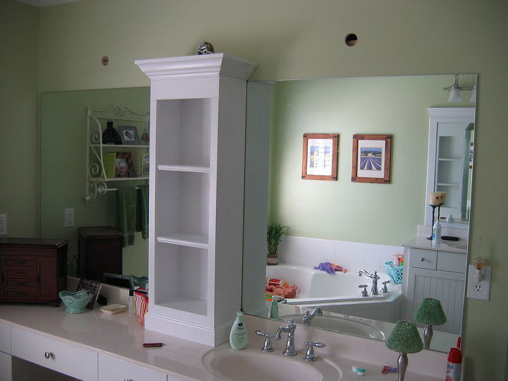 Added shelving unit and attached to wall just above mirror to help anchor the weight
