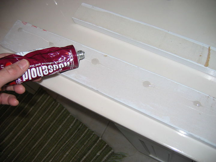 Used GOOP adhesive to position MDF on mirror front.  It was held in place by tape until it dried