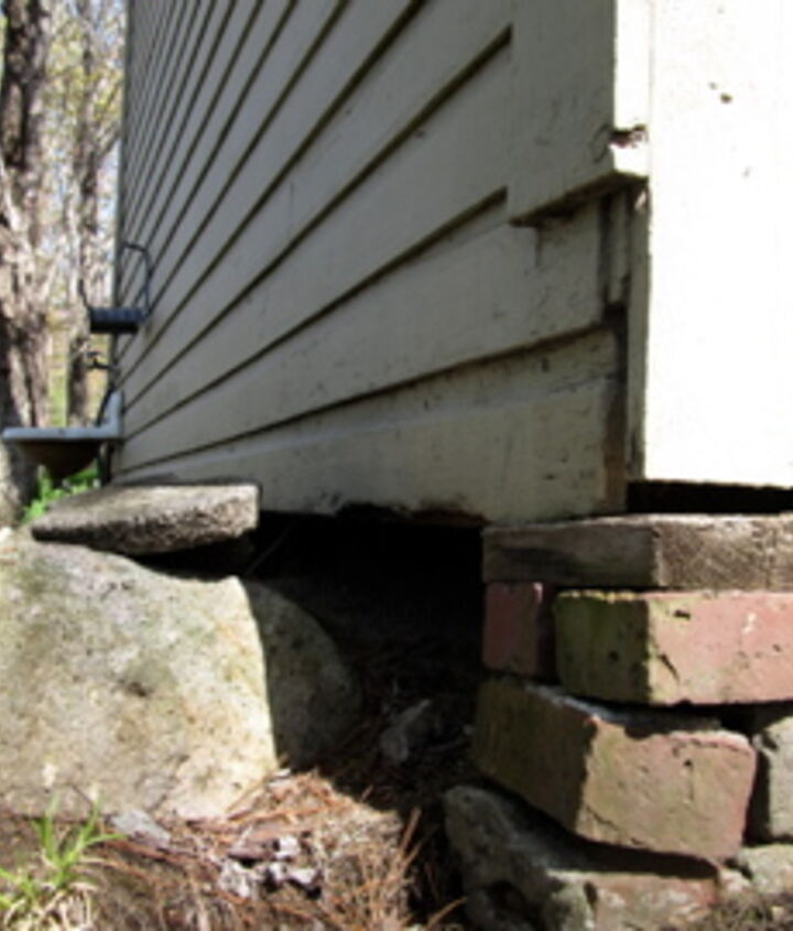 The old shed had crumbling bricks for posts.