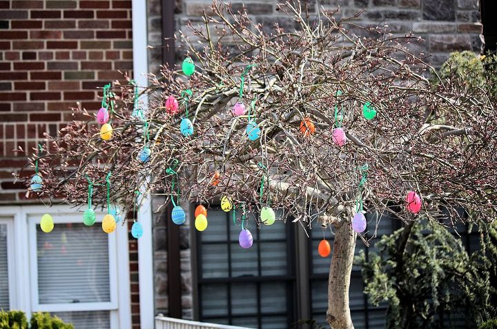 Blooming Spring trees decorated with colorful Easter eggs! Pick some up at your local Michael's, supermarket or pharmacy and hang them on trees around your house. It's a great family project  to do with your kids!
