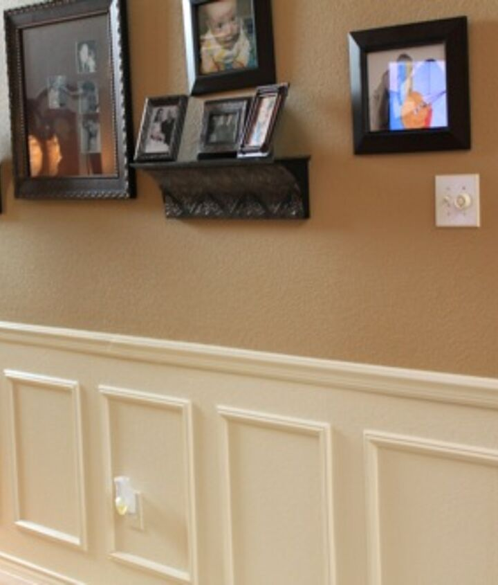 fake wainscoting tutorial, home decor, paint colors, painting, wall decor, The box frames I actually cheated and bought already made at Lowe s You can find them in their molding section It is a bit more expensive to do it this way but when you are short on time and short on the right tools this is a great solution Plus there is no mitering to do But all you have to do with them is paint the same color as your white wall color and nail them up And you might notice there is a big difference in the above pictures the most recent picture is the one with the grey walls We re painted everything recently