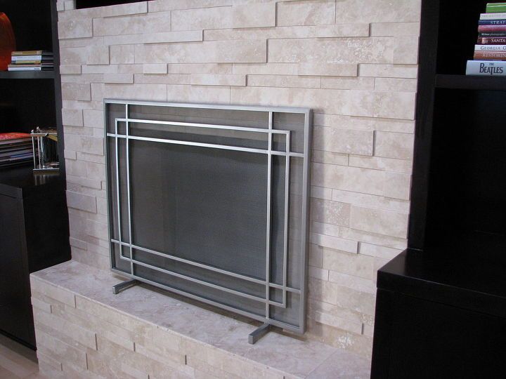 We used travertine tile to create this dimensional look on our redesigned fireplace.