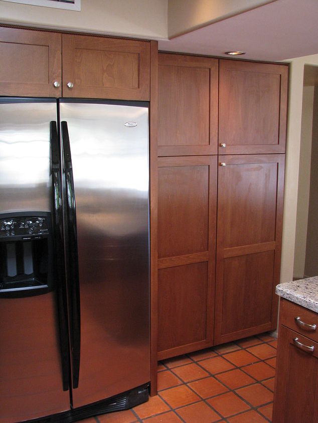Another attractive feature of this kitchen remodel included creating this built-in look for the refrigerator and the unified look of the refurbished pantry.