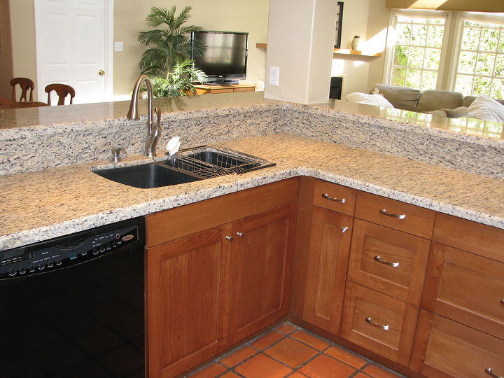 Adding new doors and drawer fronts coupled with the new granite counter tops made this kitchen an inviting part of their new great room that includes both the family room and spacious dining area.
