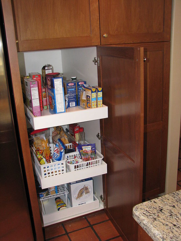 We replaced the worn out shelving and reversed the door swing to create more comfortable access to the refaced pantry.
