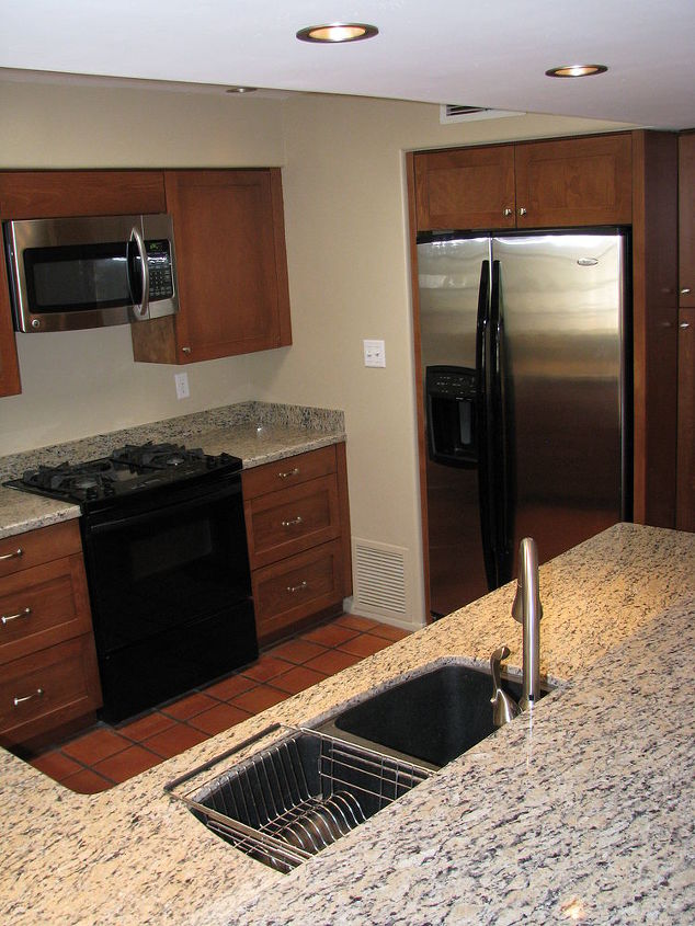 New owners called for a new look and functionality for this outdated kitchen in central Phoenix. Our clients wanted the warmth of natural wood to replace utilitarian style, white laminated cabinets, and the worn butcher block counter tops.