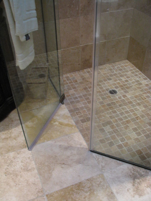 We were able to create this shower without a raised threshold to replace the previous closed in shower.