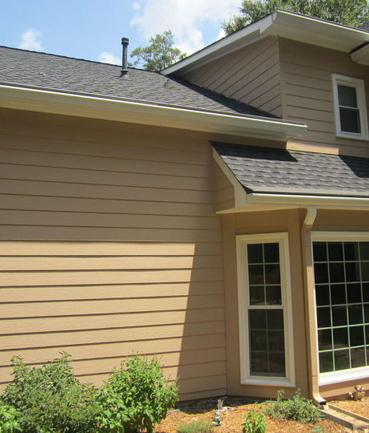 Pick a place on the downspout elbow to match the sight line of the siding.